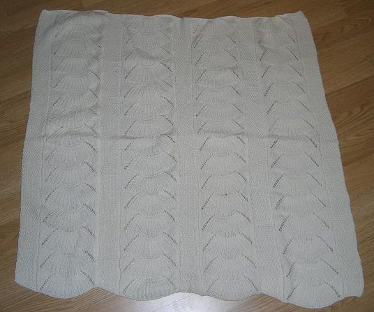 Babyteppe med skjellmønster